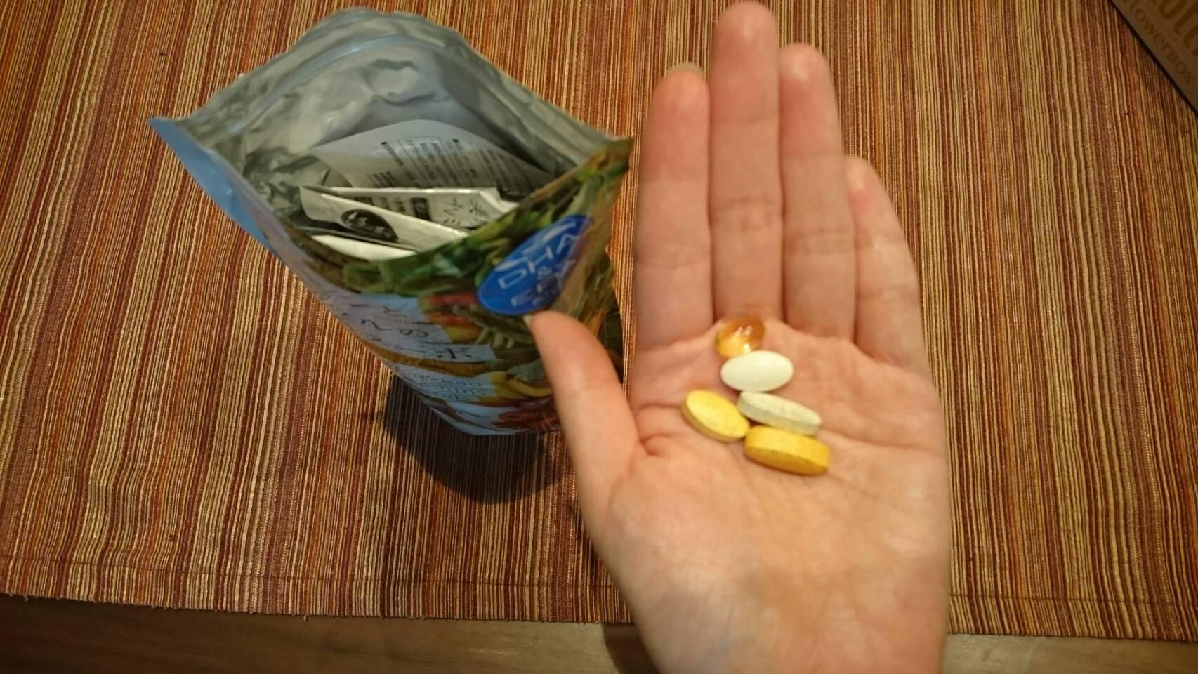 美的ヌーボプレミアムと手のひらと粒
